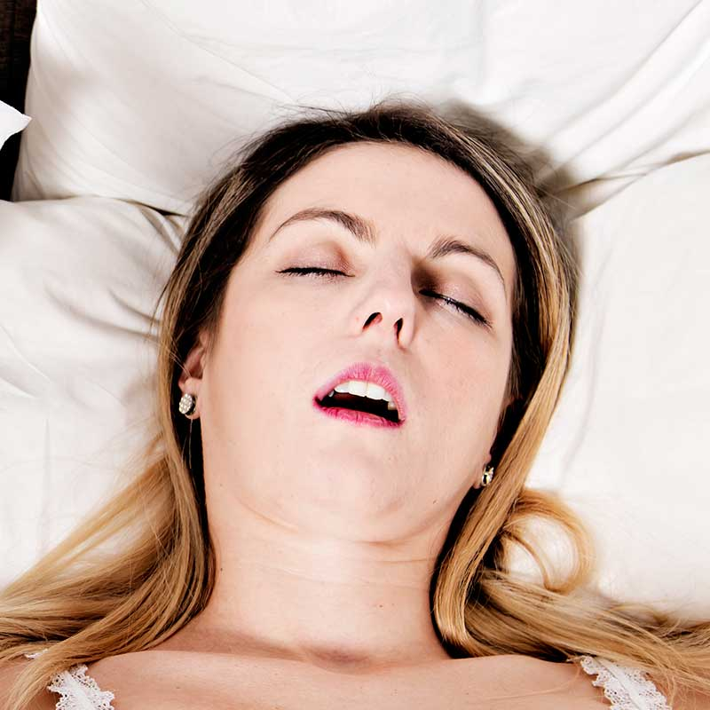 Woman in bed snoring